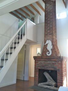 Fireplace (non-working) with stairs to loft