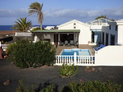 Photo for Fantastic Located Villa with Heated Pool  Hottub Wifi and turfed green Bbq area