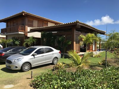 Photo for House in Praia do Forte, 5 suites w / air, 100m from the beach natural pools