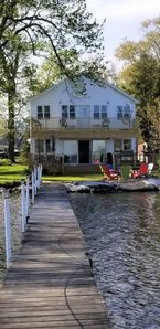 Photo for Bemus Point lakefront family home with deck, dock, boat slip, sunroom with view