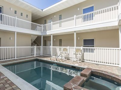 Photo for Condo 1/2 block from beach with pool and hot tub! Ocean view from condo!