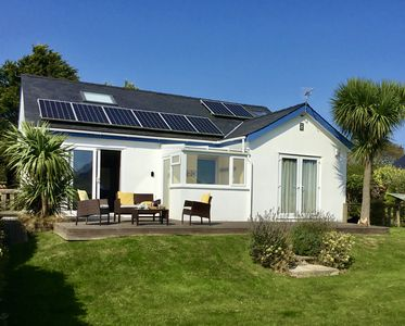 Photo for Nr Abersoch 4 bed home sleeping 8 sea views set in large family friendly garden