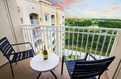 Sit out on your private furnished balcony with a glass of your favourite drink (views may vary).
