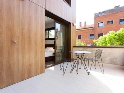 Photo for Bright apartment with private terrace in the upper part of Gràcia for 4