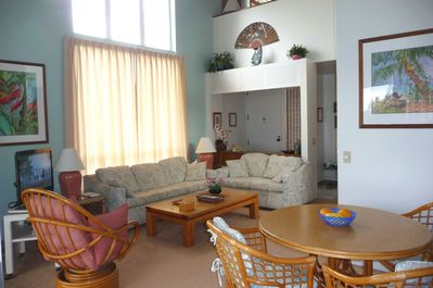 Lovely Living and Dining Areas with Ceiling Fan and terrific Ocean View