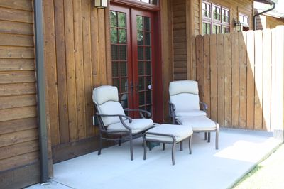 Porch seating out back with access to walking trails.