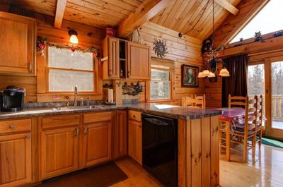 Kitchen with dish washer.