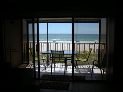 view from inside the condo and balcony - right ON the beach!
