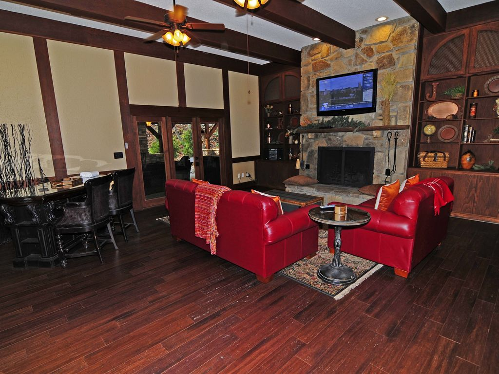 Bedroom stone fireplace - Property Image 5 Classic Elegance 3 Bedroom 2 Bath With Outdoor Stone Fireplace And