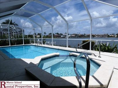 Photo for Enjoy the Wide water view from this beautiful home on Landmark w/ heated Pool/ Jacuzzi home close to a beach entrance