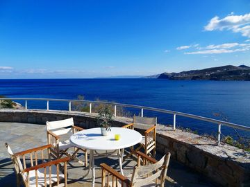 Idyllic stone and wood villa with stunning, panoramic views of the Aegean Sea
