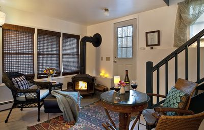 Cozy up to a romantic fire in the wood-burning fire stove in the winter