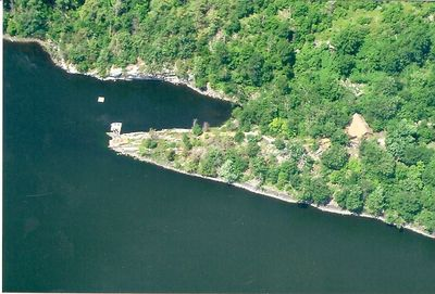 From the air with the cottage to the right and swimming area left of center.