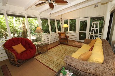 Front Lanai of this property that offers wood floors throughout, 2 TVs, DVD Player, washer/dryer, BBQ Grill, stereo w/CD player and free wi-fi.
