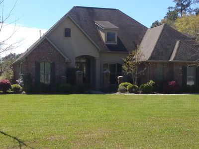 Four Oaks, minutes to charming downtown Covington in secluded cul-de-sac.