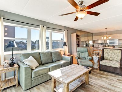 Photo for 1st Floor Corner 2 Bed/2 Bath Oceanfront condo sleeps 6.  W/D, pool, tennis and private fishing pier!