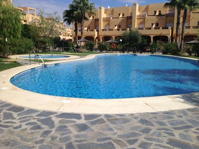 Photo for Ground floor, pool facing 2 bedroom 2 bathroom apartment on secure gated complex