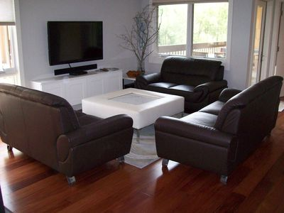 Photo for Modern fully remodeled condo steps from shuttle with balcony, hot tubs & pool
