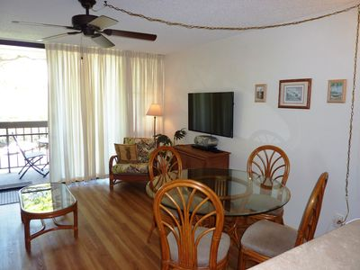 Living space with ceiling fan, sitting area and large flat screen SMART TV!