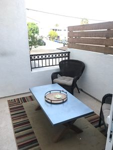 Photo for Rooftop deck, beautiful sunsets, walk to beach, wonderful restaurants.