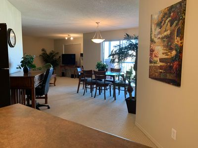 Photo for Quiet Spacious Top Floor Unit with A/C, UG parking, close to airport