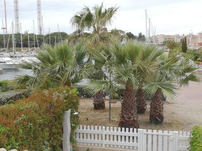 Photo for Cap d'Agde: Air-conditioned apartment on the island with private beach, parking, harbor view