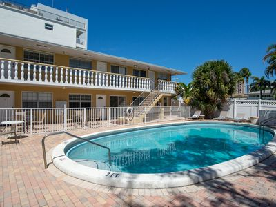 Photo for Bright, cozy condo w/ shared pool, & patio - walk to the beach!