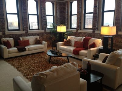 Exposed brick very spacious living room.  Fabulous view!