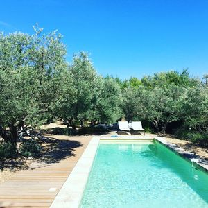 Photo for Heated pool, pétanque area, nice decoration and standing near Lourmarin