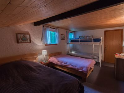 Photo for Charming Swiss Chalet in the heart of the Laurentians