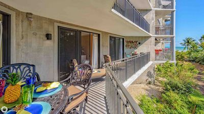 The large balcony offers multiple seating and lounging options...
