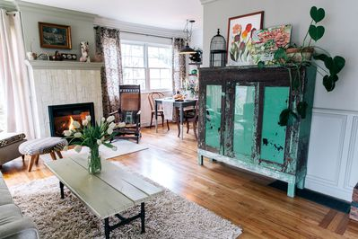 Living room with fire place and hidden tv inside green hutch:)