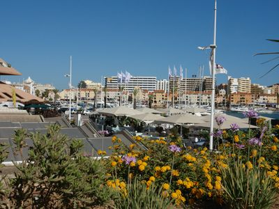 Photo for Modern apartment building right by the marina, 10 minutes easy walk to the beach