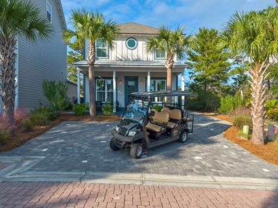 Photo for Beautifully updated Beach Home with Golf Cart & Paddle Boards! 1 min ride to Beach! Community Pool