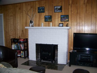 Enjoy a comfy living rm with fireplace, DVD/VCR, Dish TV,games & books.