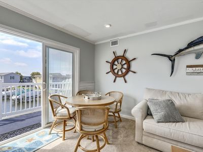 Photo for Enjoy the great views from your balcony! 2nd floor property with one assigned parking space. Central air, a washer, dryer, dishwater and fully equipped kitchen. Boat dock not included with the rental.