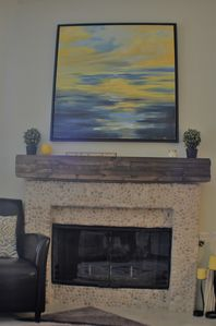 Gas Fireplace with reclaimed wood mantle