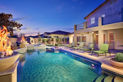 Relax and enjoy your resort style backyard with heated pool and spa.
