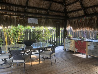 Outdoor tiki area , large granite table sits 6 or more