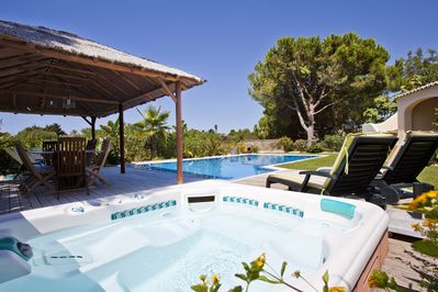 Private garden with pool, hot tub and BBQ area.