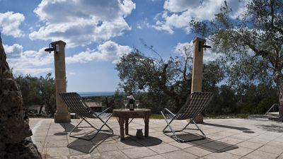 Photo for Ancient Trullo of Salento over the sea of Pescoluse, Salento. Panoramic views.