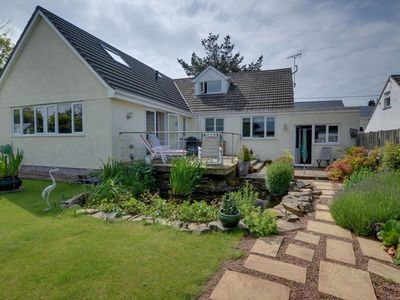 Photo for Comfortable holiday home with pond and gas fireplace, nearby the coast