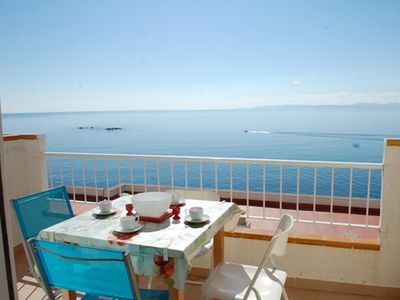 Photo for A magnificent view, sun terrace, swimming pool located on the rocks overlooking the sea