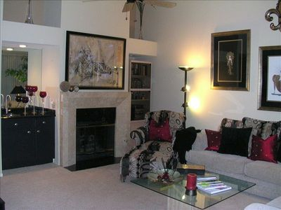 gorgeous, warm, inviting living room!  fireplace, wet bar, plenty of seating!