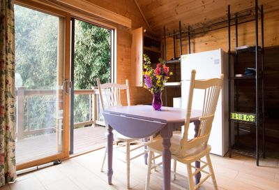 Enjoy the riverside view from your dining area.