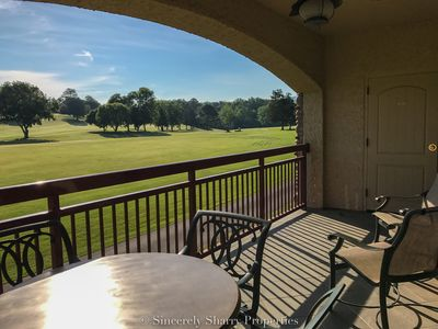 Photo for Overlooking the golf course from the back & amenities from screened front porch~