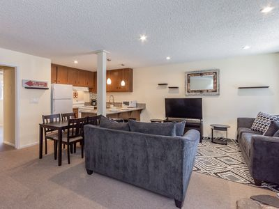 Photo for Charming mountain condo steps from downtown with community pool and hot tub