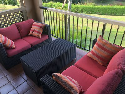 """Lanai with matching love seats has a """"sea to summit"""" view - ocean and volcano."""