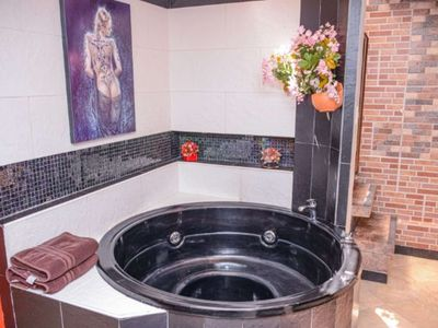 Photo for Two Bedroom AC Hot tub 2 blocks Lleras