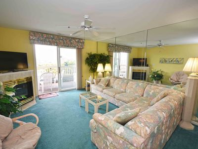 Photo for Relax and enjoy this two BD condo on the bay side with an outdoor pool and free WiFi, close to a lot of activities